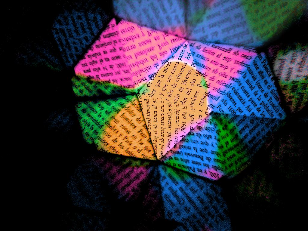 Fotografía sacada a un libro con un caleidoscopio. Pintada con PicsArt, más un filtro de Instagram.